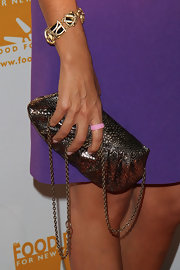 Hoda Kotb clutched a metallic evening bag with a chain handle at the Can-Do Awards Dinner.