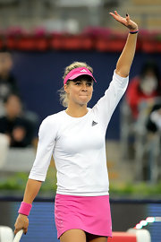 Maria Kirilenko was easy to spot in this bright pink visor.