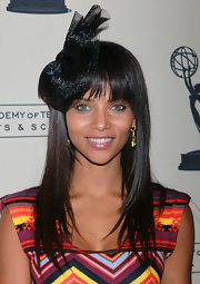 Denise Vasi styled her hair in a straight hairstyle with blunt cut bangs.