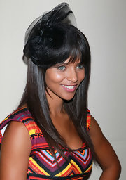 Denise Vasi added a classic touch to her chic outfit by wearing a gorgeous fascinator.
