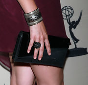 Stephanie paired her maroon dress with a black gemstone cocktail ring.