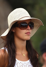 Ana Ivanovic exuded a summer vibe with this straw hat and oversized sunnies at the 2011 Emirates Australian Open.