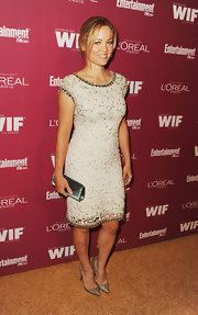 Erika shined on the red carpet in a lace cap sleeve beaded dress paired with classic metallic stilettos.