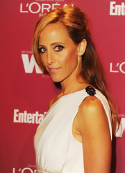 Kim Raver wore her hair pinned backed, with a slight tease at the crown, for the 2011 Entertainment Weekly and Women in Film Pre-Emmy Party.
