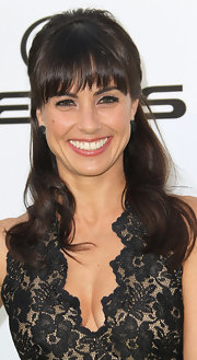 Constance Zimmer wore her hair in a half up, half down 'do at the 2011 Environmental Media Awards. She kept brow-grazing bangs straight and added a little curl to the longer lengths.
