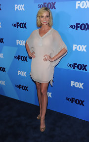 Jaime Pressly balanced her filmy tunic dress with olive suede peep-toes.