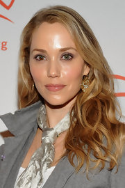 Elizabeth Berkley wore her gold waves down at an event held at The Waldorf.