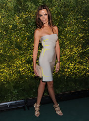 Almudena poses seductively in a strapless gray and neon mini dress at the Green Auction in NYC.