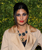 Rachel Roy wasn't afraid of a little color at the 2011 Green Auction event. She paired her vivid red lips with deep purple shadow that was rimmed around her upper and lower lids.