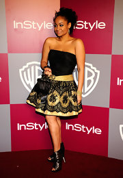 """At the 2011 """"InStyle"""" Golden Globes party, Raven-Symone donned lace peep toe ankle boots."""