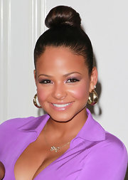 Christina Milian perfectly paired her purple dress with a shimmering shade of pale lilac eyeshadow. She called attention to her lids with black liner rimmed around her eyes.