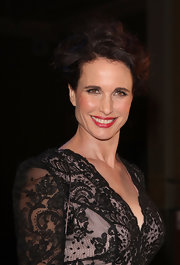 Andy McDowell showcased her lace clad dress with a messy updo. A subtle side part completed her glamorous look.