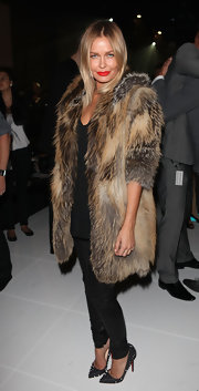 Lara looks extravagant in a thick fur coat at the Melbourne Fashion Festival.