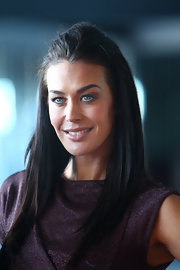 Megan Gale showed kept her look simple with straight tresses at Melbourne Fashion Week.