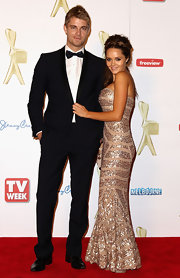 Rebecca Breeds amped up the glam with a strapless sequined mermaid gown at the Logie Awards.