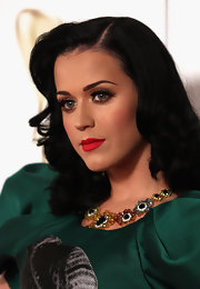 Katy Perry amped up her look with fluttering lashes at the 2011 Logie Awards.