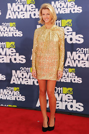 Brooklyn Decker paired her gold sequined shift with black suede pumps.