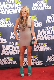 Amanda went for a daring look in a nude bandage dress at the MTV Movie Awards.