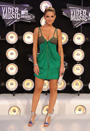 Maria Menounos showed off her sexier side at the 2011 VMAs. She accessorized her green dress with galactic-inspired metallic strappy sandals.