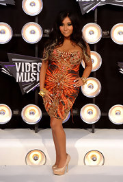 Nicole 'Snooki' Polizzi stepped up the glamour at the MTV VMAs in a strapless orange and black Ema Savahl cocktail dress encrusted with an abstract design.