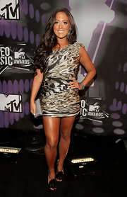 Sammi 'Sweetheart' Giancola showed off her tan in a one-shoulder mini dress. The fierce frock featured varied animal prints in a pleated pattern that gave the sexy dress a figure-flattering texture.