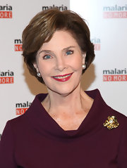 Laura Bush stepped up the sophistication with a lovely gold-and-pearl brooch.