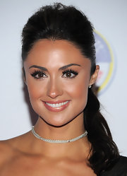 Katie Cleary knows how to make her pout stand out. She amped up her look with shimmering champagne lip gloss.