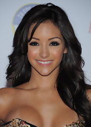 Melanie Iglesias gave her look a boost with smoldering smoky eyeshadow. She kept the rest simple with a light application of lip gloss.