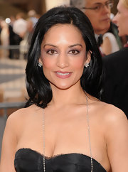 Archie Panjabi wore a pair of diamond cluster earrings at the Metropolitan Opera's opening night of 'Anna Bolena'. She also accented the look with a diamond chain necklace.