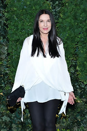 Marina Abramovic kept it simple with a loose white blouse and black leggings.