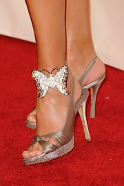 Linda Thompson probably wanted more sparkle to her glam silver sandals, hence the rhinestone butterfly.
