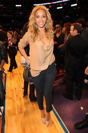 Beyonce Knowles added sparkle to her courtside attire at the NBA All-Star Game with crystal-adorned Daffodile platforms.