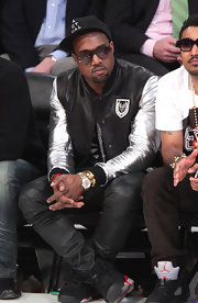 Leave it to Kanye to bring the bling to the NBA All-Star GAme! Sitting courtside, Kanye rocked a gold Love bracelet by Cartier.