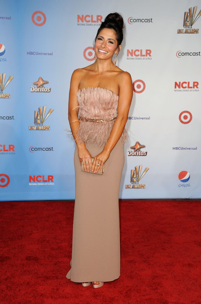 Sarah Shahi shined on the red carpet at the ALMA awards in a blush strapless feather gown.