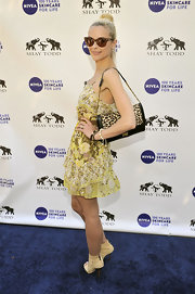 Jaime King gave her sunny yellow frock a hint of an edge with a leopard print Cassie chain strap bag.