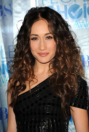 Nikita actress Maggie Q amped up her hair routine with loads of voluminous curls. Parted down the center her soft textured ringlets stood out amongst the heaps of polished 'dos.