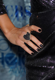 Vanessa Williams paired her sparkling sequined dress with a gunmetal stone encased in gold.