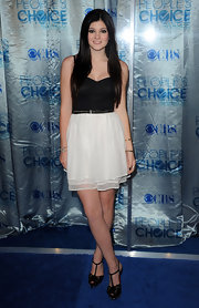 Kylie Jenner toughened up a sweet black and white cocktail dress with spike embellished Christian Louboutin platforms.
