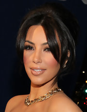 Kim Kardashian highlighted her plump lips with shimmering nude lipstick.