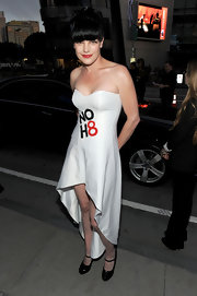 Pauley gave her white strapless dress a girlish finish with black maryjane pumps.