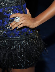 Tiffany paired her feathered frock with midnight blue nail polish.