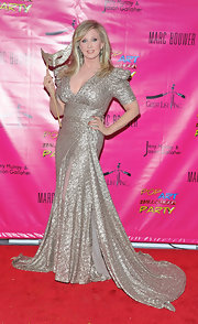 Morgan Fairchild looked dramatic at the Pop Art Halloween party in a silver evening gown with a long train and mascaraed mask.