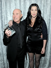 Cher chose a slinky lingerie-inspired LBD for her 2011 pre-Grammy gala look.