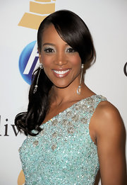 Shaun Robinson heightened the drama of her sequined blue dress with stunning silver drop earrings with dangling crystals.