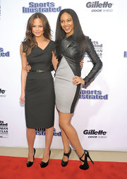 Ariel Meredith added edge to her sleek gray sheath dress with a leather wrap jacket.