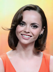 Christina Ricci was bright and sunny for the TCA press tour in Beverly Hills. She donned an orange v-neck dress that she paired with a sweet bob.