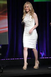 Anna Paquin paired her white Stella McCartney frock with strappy nude heels and tousled waves.