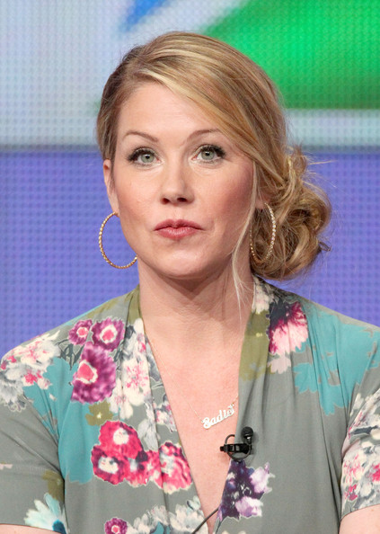 Christina Applegate paired her floral frock with a messy side bun.