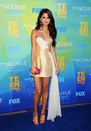 Selena Gomez put her best foot forward at the Teen Choice Award in purple Betsy sandals with peach ruffle details. The delightful heels gave her champagne frock a feminine finish.