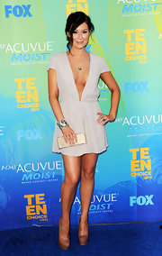 Alexa Vega finished off her sexy plunging neckline frock with a green crystal statement cuff.